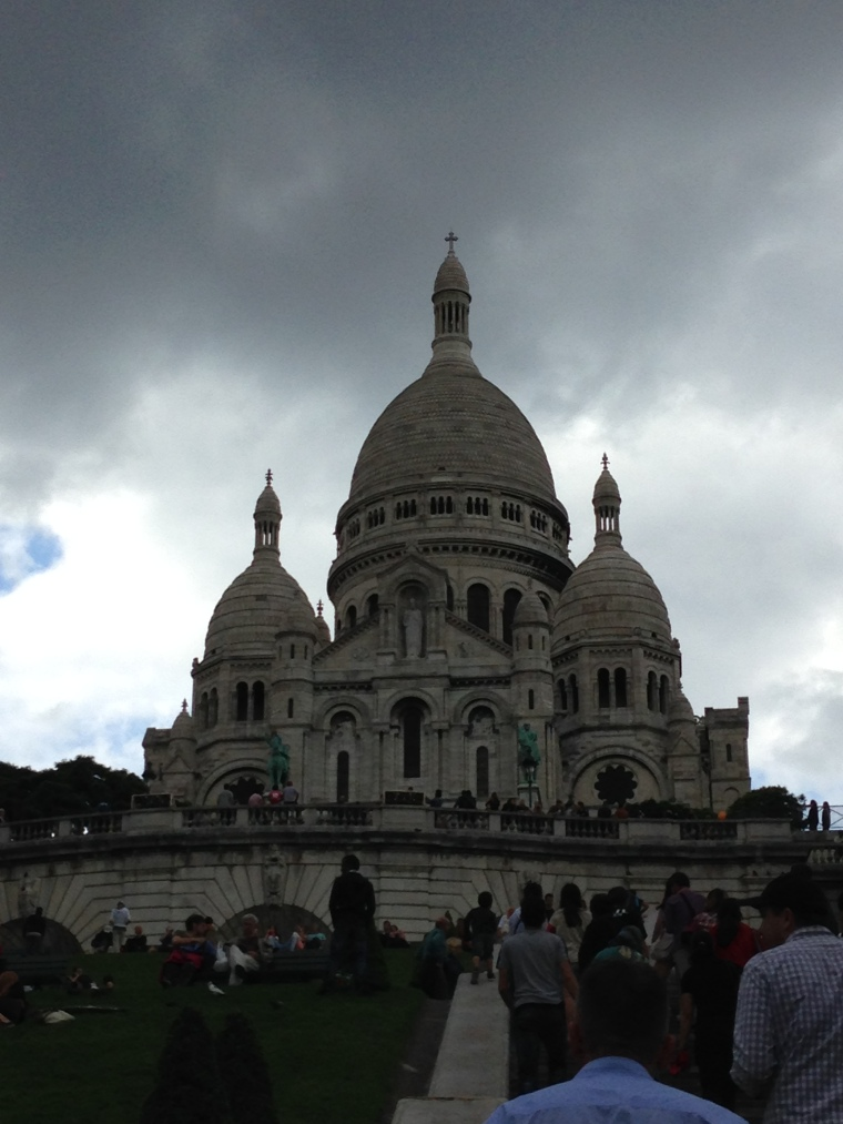 Storm clouds loomed as we ascended the steps to the basilica.