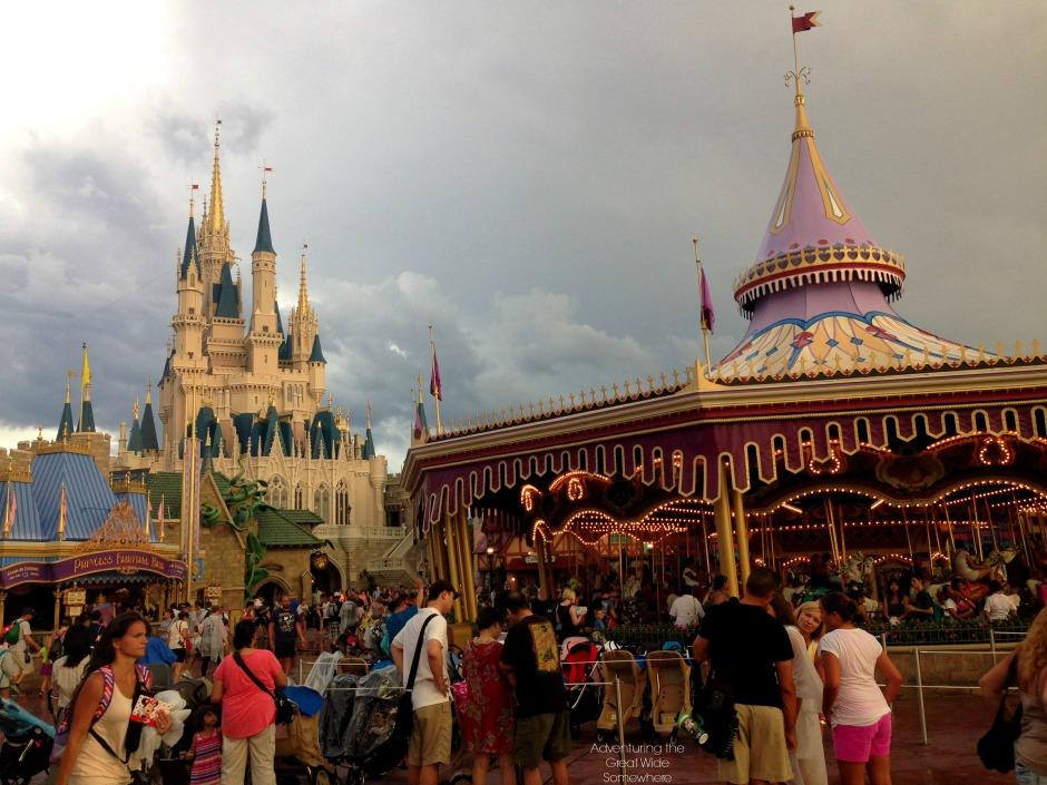 Cinderella Castle and the Carrousel against a gray, rainy sky