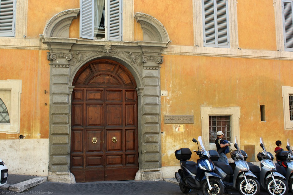 motorcycles-and-elaborate-doors-on-the-streets-of-rome-italy